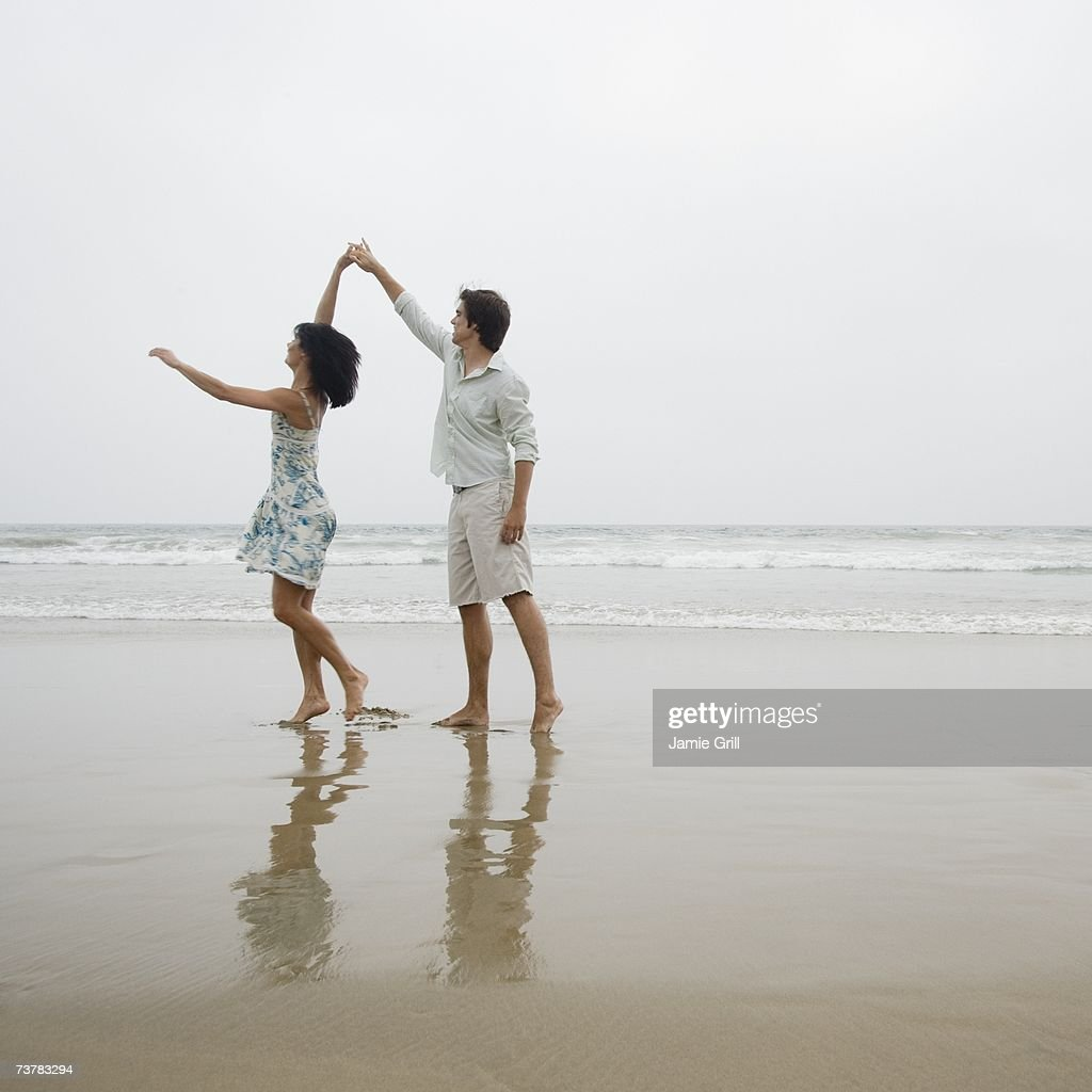 Couple dancing on beach : Stock Photo