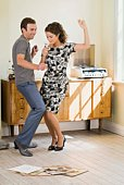 Couple dancing to music on record player