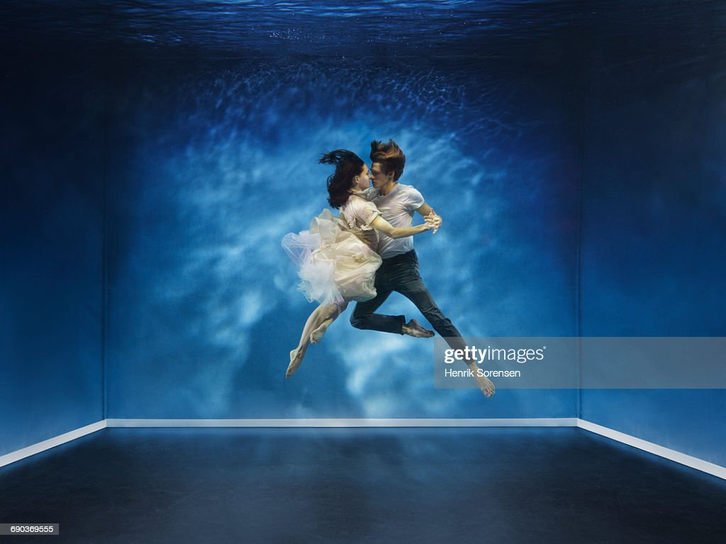 A couple dancing under water : Stock Photo