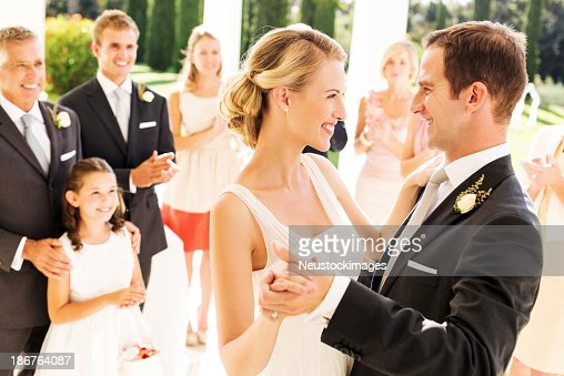 Couple Dancing With Guests Clapping In Background