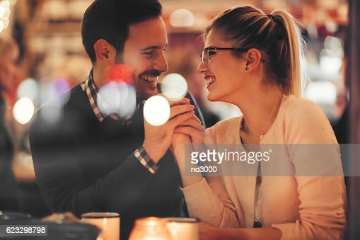 Couple dating at night in pub : Stock Photo