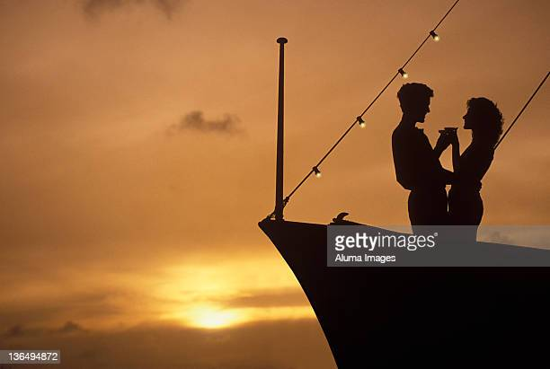 Couple dating/toasting on a yacht.
