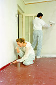 Couple decorating a room