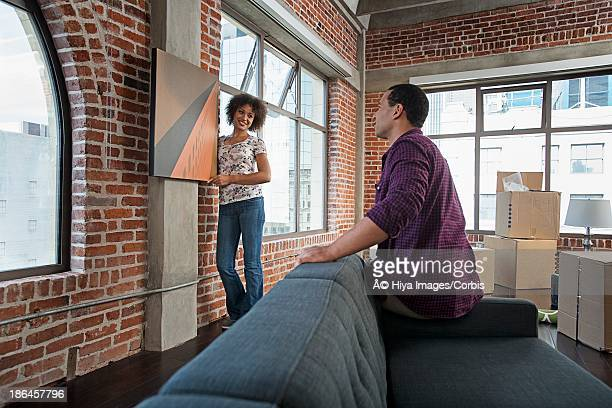 Couple decorating new apartment