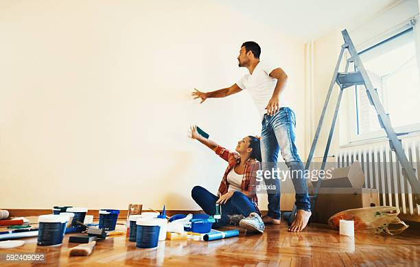 Couple decoration their apartment.