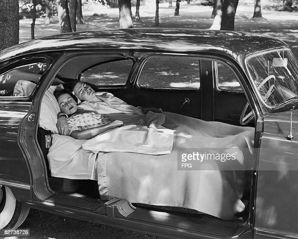 A couple demonstrate the sleeping arrangements available in the 1949 Nash
