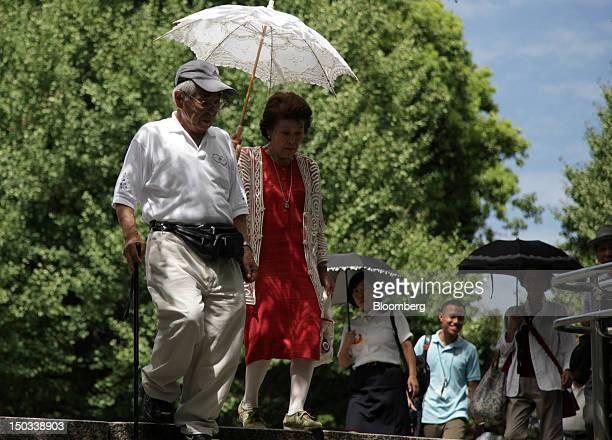 A couple descends a flight of stairs at a park in Tokyo Japan on Thursday Aug 16 2012 With 7 million baby boomers starting to retire this year and...