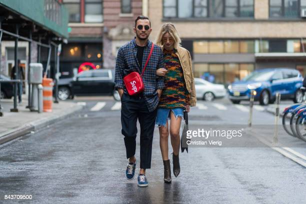 Couple Dima wearing Balenciaga shirt Supreme x Louis Vuitton bag and Lisa Hahnbueck wearing wearing mustard bomber jacket Missoni sweater cutted...