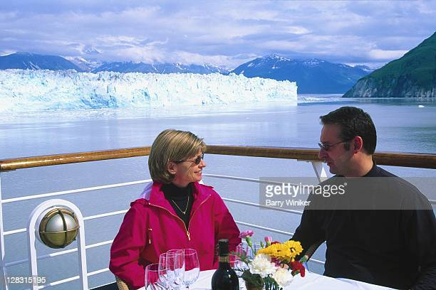 Couple dining on deck of cruise ship, Alaska