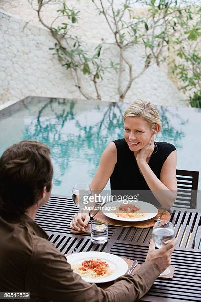 Couple dining outdoors