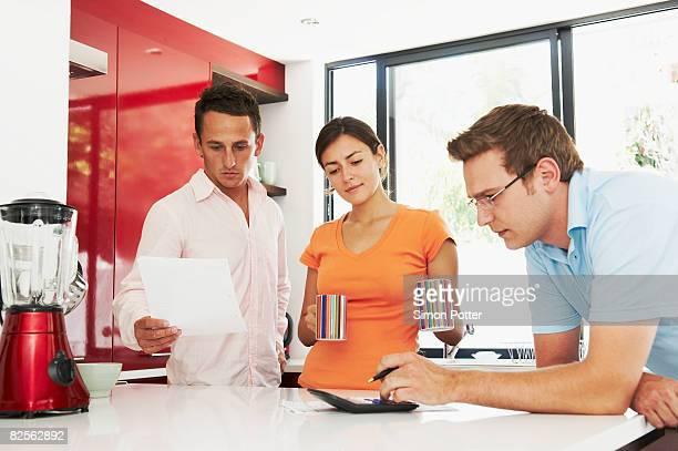 Couple discuss finances with advisor