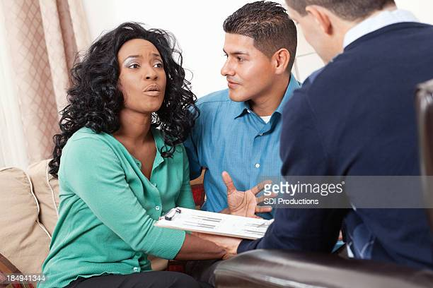 Couple discussing financial situation with their advisor