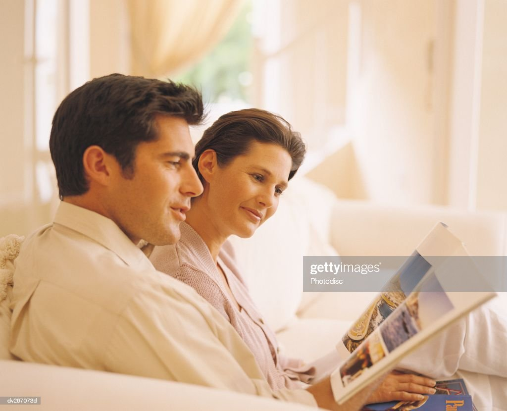 Couple discussing travel brochure