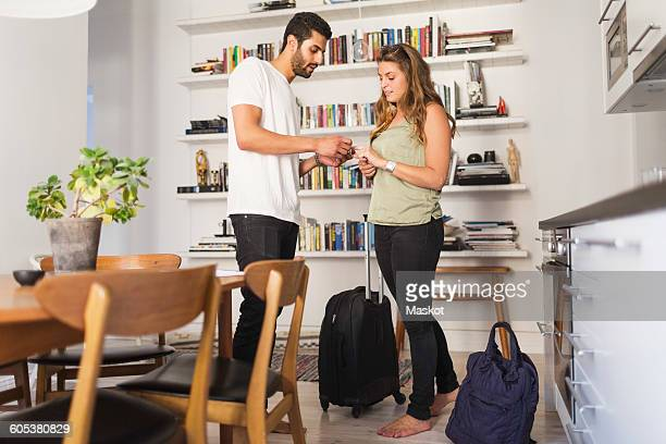 Couple discussing while going for vacation at home