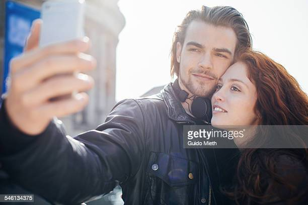 Couple doing a selfie outdoor.