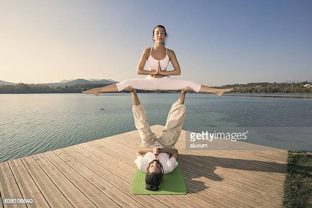 Couple doing acroyoga in nature