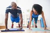 Couple doing push-ups in gym