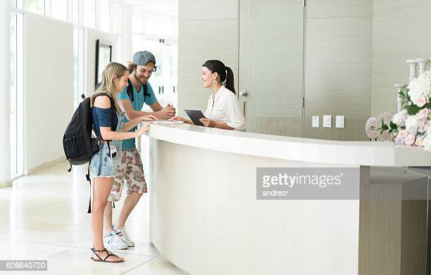 Couple doing the check-in at a hotel