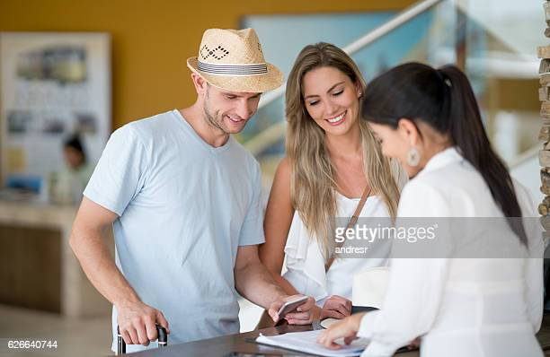 Couple doing the check-in at the hotel