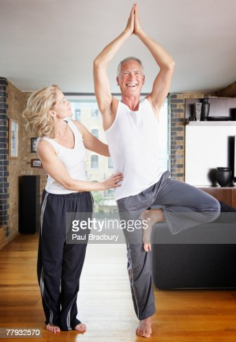 Couple doing yoga in living room stock photo getty images for Living room yoga