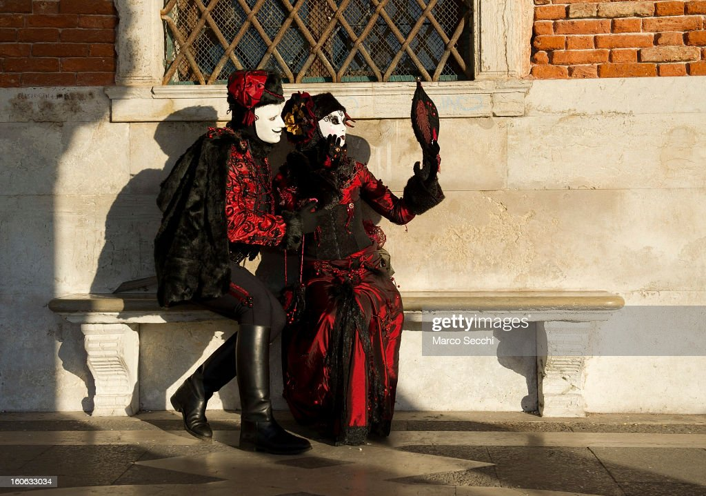 A couple dressed in costume pose in Saint Mark's Square during the Venice Carnival 2013 on February 4, 2013 in Venice, Italy. The 2013 Carnival of Venice runs from January 26 - February 12 and includes a program of gala dinners, parades, dances, masked balls and music events.