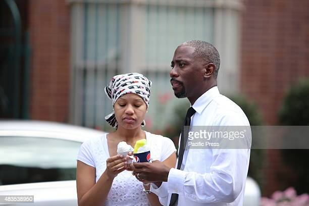 Couple dressed in white enjoys ice cream after street baptism on 116th Street The United House of Prayer for All People staged its annual street...