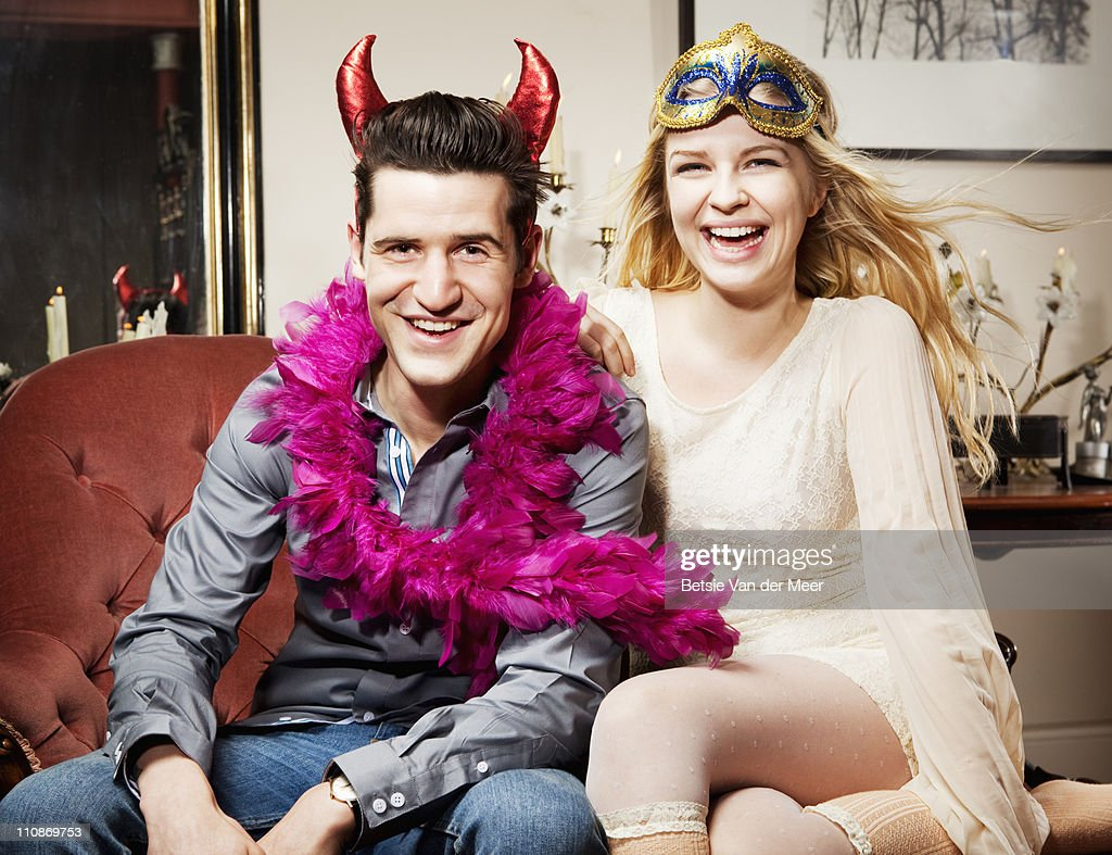 Couple dressed up, laughing. : Stock Photo