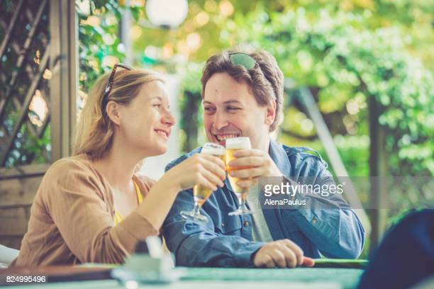 Couple drinking beer outdoors