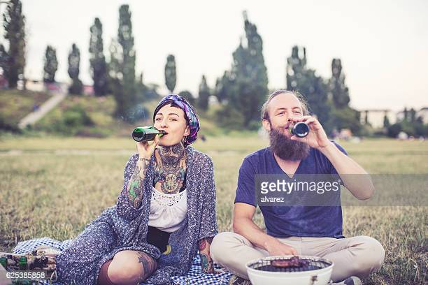 Couple drinking beers on picnic