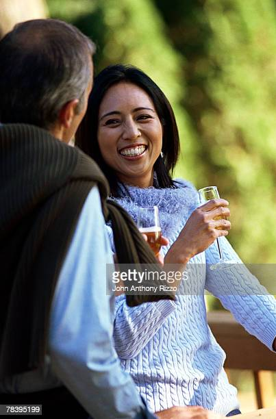 Couple drinking champagne and laughing