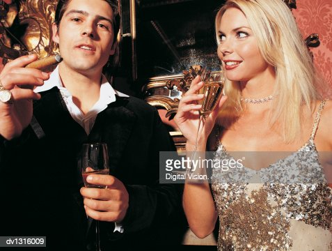 Beautiful Women Smoking Cigars Stock Photos And Pictures