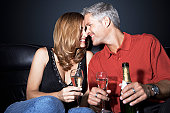 Couple Drinking Champagne in Limousine