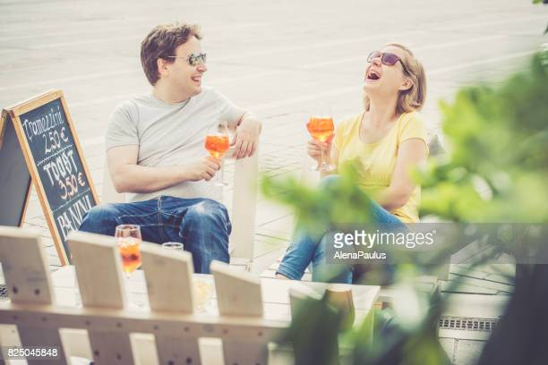 Couple drinking cocktail outdoors