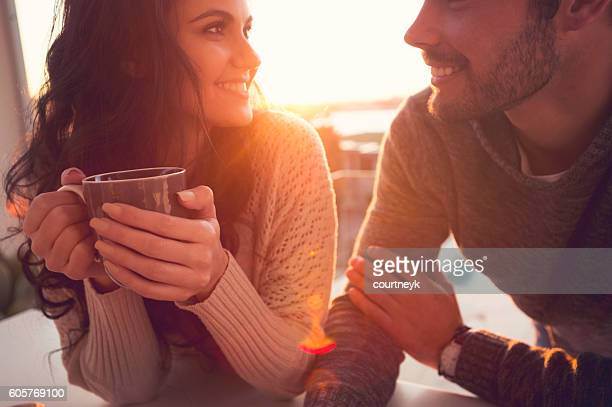 Couple drinking coffee and talking.