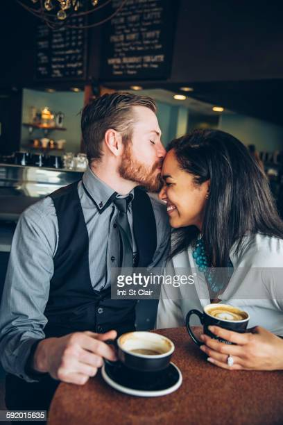 Couple drinking coffee in cafe