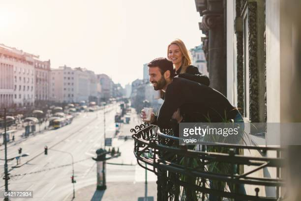 Couple drinking coffee on hotel balcony