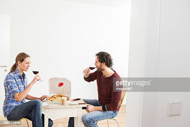 Couple drinking drink in new house