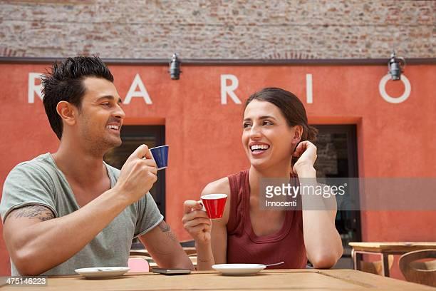 Couple drinking espressos outside cafe, Florence, Tuscany, Italy