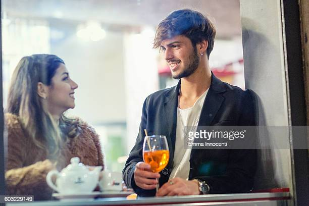 Couple drinking inside bar in winter