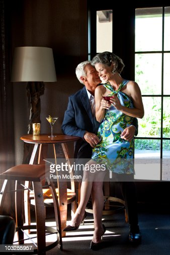 Couple drinking martinis at upscale bar : Stock Photo