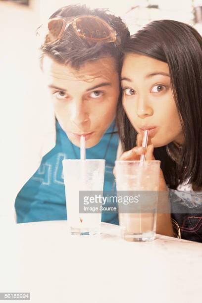 Couple drinking milkshakes
