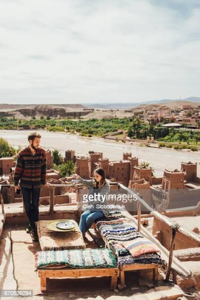 Couple drinking tea in Ait Ben Haddou Casbah
