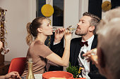 Couple drinking to close friendship on New Years Eve