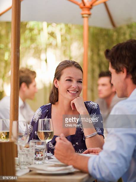 Couple drinking wine at restaurant table