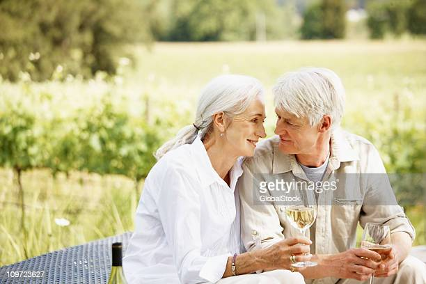 Couple drinking wine at the countryside