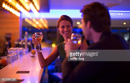 Couple drinking wine in a hotel bar