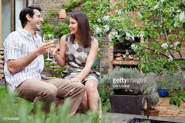 Couple drinking wine together outdoors