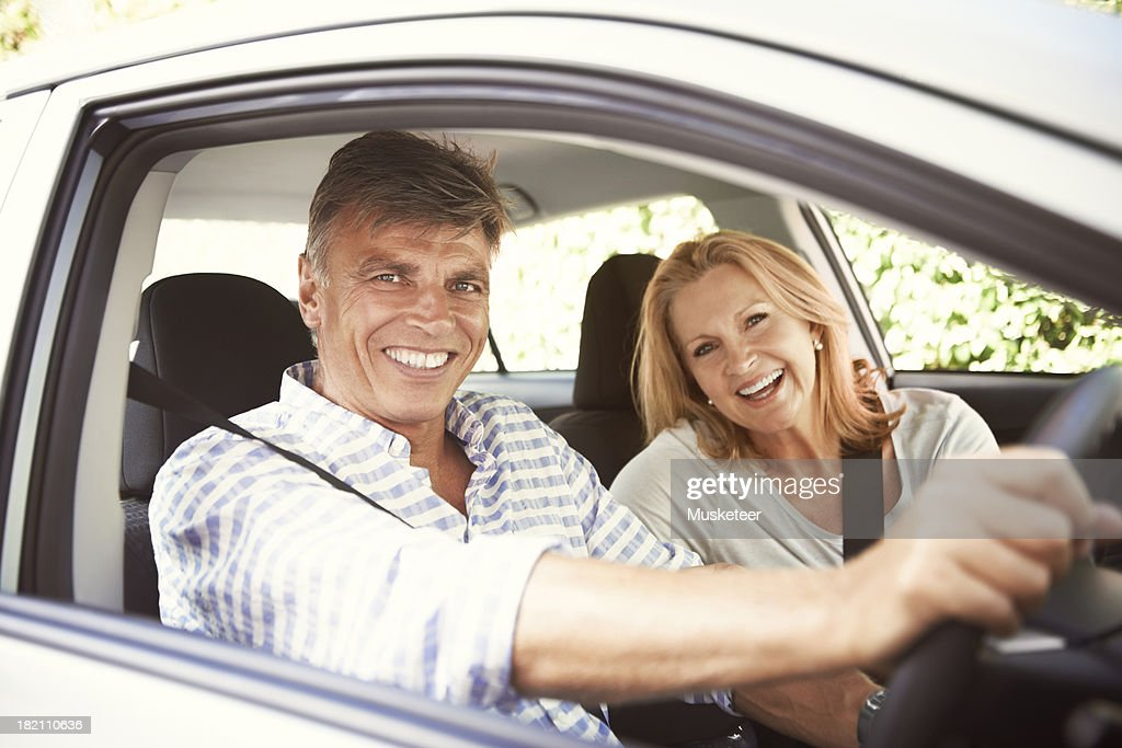 Couple driving in a car : Stock Photo