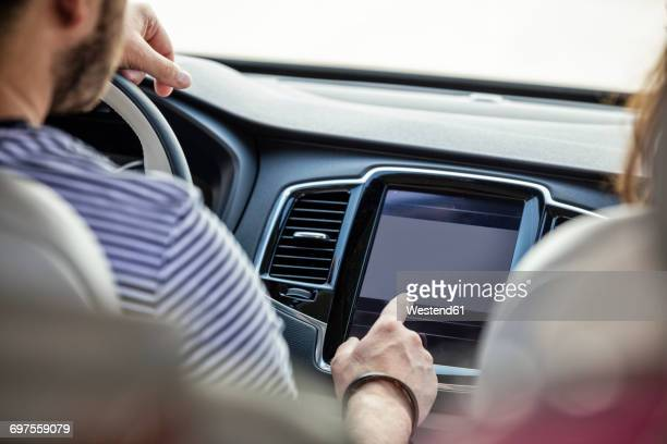 Couple driving in car