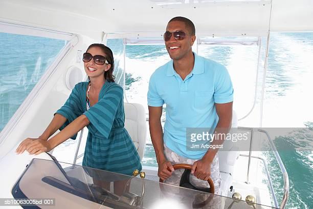 Couple driving speedboat